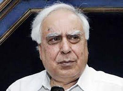 Sibal defends telecom firms, says TRAI is showing zero tolerance