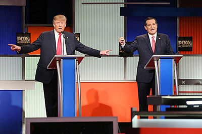 NORTH CHARLESTON, SC - JANUARY 14: Republican presidential candidates (L-R) Donald Trump and Sen. Ted Cruz (R-TX) participate in the Fox Business Network Republican presidential debate at the North Charleston Coliseum and Performing Arts Center on January 14, 2016 in North Charleston, South Carolina. The sixth Republican debate is held in two parts, one main debate for the top seven candidates, and another for three other candidates lower in the current polls.   Scott Olson/Getty Images/AFP == FOR NEWSPAPERS, INTERNET, TELCOS & TELEVISION USE ONLY ==