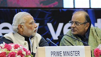 Prime Minister Narendra Modi (L) and (R) Former Finance Minister Arun Jaitley