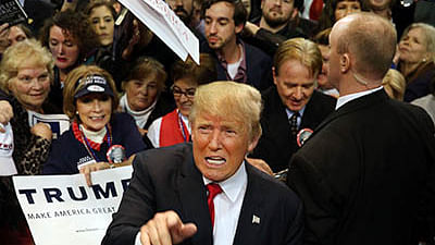BILOXI, MS - JANUARY 02: Republican presidential frontrunner Donald Trump pauses with supporters after speaking at the Mississippi Coast Coliseum on January 2, 2016 in Biloxi, Mississippi. Trump, who has strong support from Southern voters, spoke to thousands in the small Mississippi city on the Gulf of Mexico. Trump continues to split the GOP establishment with his populist and controversial views on immigration, muslims and some of his recent comments on women.   Spencer Platt/Getty Images/AFP == FOR NEWSPAPERS, INTERNET, TELCOS & TELEVISION USE ONLY ==