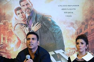 Indian Bollywood actors Akshay Kumar (L) and Nimrat Kaur address a press conference to promote their upcoming movie 'Airlift' in New Delhi on January 18, 2015.  'Airlift' is based on the world's biggest civil evacuation - that of Indians based in Kuwait during the Iraq-Kuwait war. The film is scheduled for release on January 22, 2016.  AFP PHOTO / SAJJAD HUSSAIN