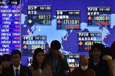 World shares mixed after Wall Steet rally as oil prices recover