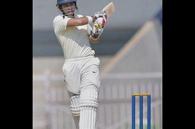 Akhil Herwadkar, Yadav steer Mumbai to 303/6