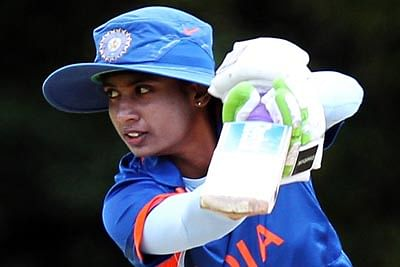CHESTERFIELD, ENGLAND - JULY 2 :    Mithali Raj of India hits out to the boundary during the NatWest Women's Quadrangular Series between Australia and India at Queens Park on July 2, 2011 in Chesterfield, England.  (Photo by Jan Kruger/Getty Images)