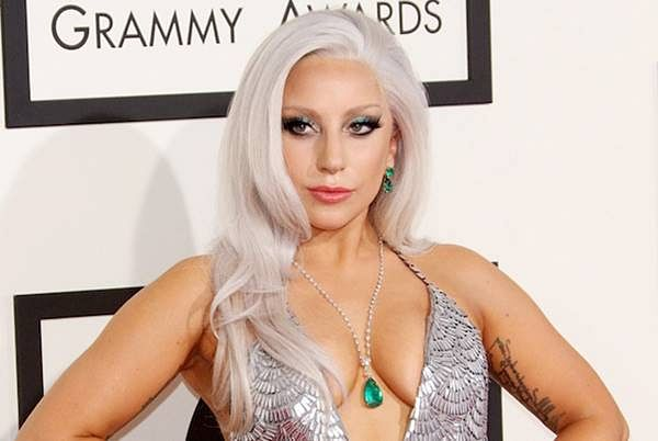 Lady Gaga kisses married trumpet player Brian Newman on-stage