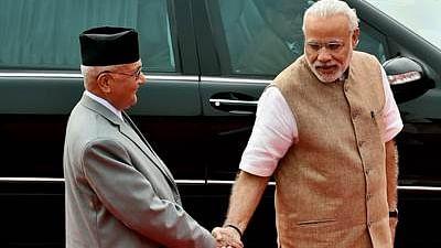 Indian Prime Minister Narendra Modi (R) receives Nepalese Prime Minister KP Oli (L) during a ceremonial reception in New Delhi