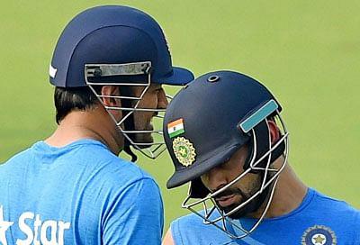 Kolkata:Indian captain MS Dhoni and his teammate Virat Kohli during a training session at the Eden Gardens in Kolkata on Wednesday. PTI Photo by Swapan Mahapatra(PTI3_9_2016_000235B)