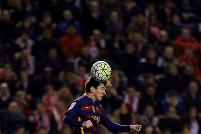 Madrid : Barcelona's Lionel Messi heads the ball during a Spanish La Liga soccer match between Barcelona and Rayo Vallecano at the Vallecas stadium in Madrid, Thursday, March 3, 2016. Messi scored a hat trick in Barcelona's 5-1 victory. AP/PTI(AP3_4_2016_000005B)
