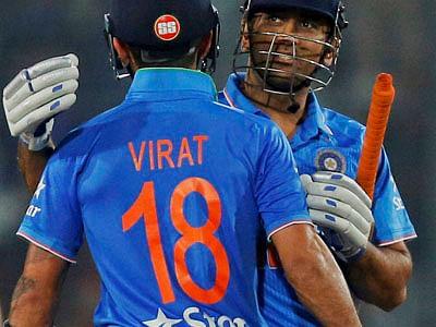 India's captain Mahendra Dhoni (R) and Virat Kohli