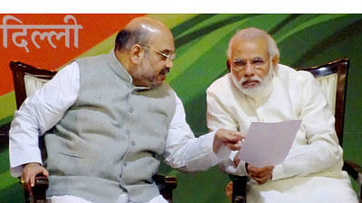 Prime Minister Narendra Modi (R) and Union Home Minister Amit Shah in conversation