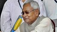 Patna: RJD chief Lalu Prasad's son Tej Pratap greets Chief Minister Nitish Kumar during the later's swearing-in ceremony at Gandhi Maidan in Patna on Friday. PTI Photo  (PTI11_20_2015_000147B)
