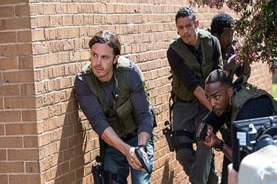 Triple 9: Bloody and brutal