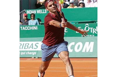 Monaco :  Swiss player Roger Federer plays a return to Guillermo Garcia Lopez of Spain during their match of the Monte Carlo Tennis Masters tournament in Monaco, Tuesday, April 12, 2016. AP/PTI Photo(AP4_12_2016_000362B)