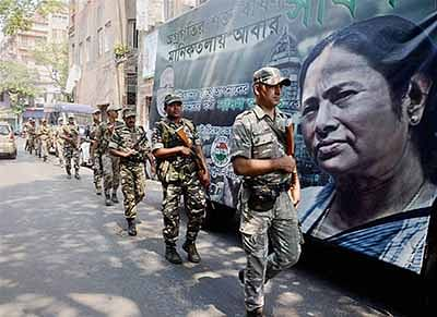 Kolkata: Central Force Jawans conduct a flag march ahead of Assembly polls in Kolkata on Tuesday. PTI Photo (PTI4_19_2016_000106B)