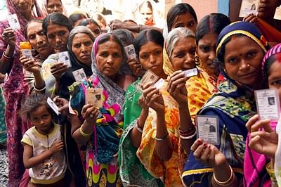 Gaya: Voters stand in queue to cast votes during the first phase of Panchayat polls in Gaya on Sunday. PTI Photo  (PTI4_24_2016_000206B)