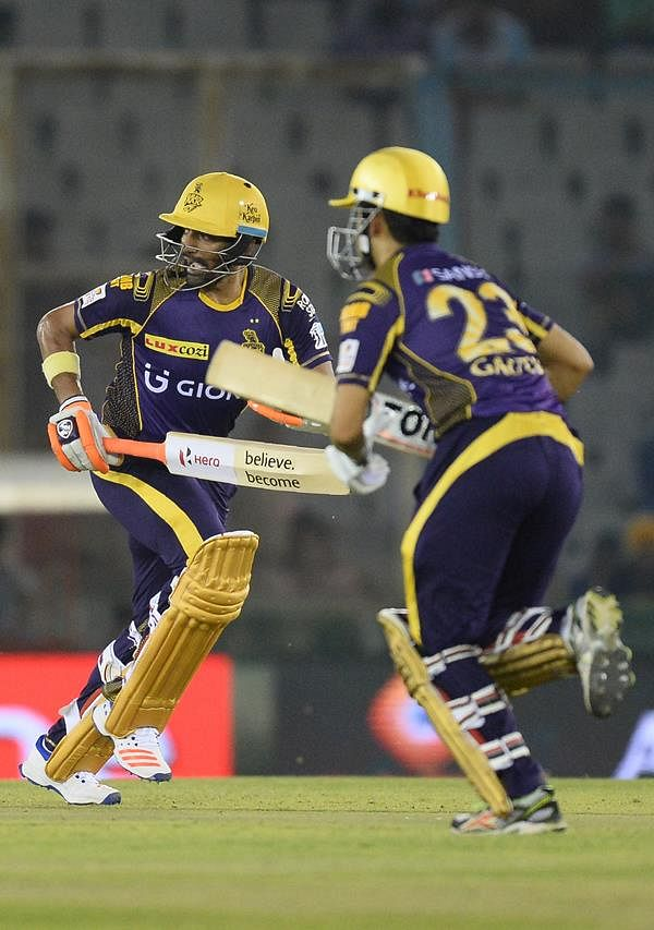 <strong>Kolkata Knight Riders batsman and captain Gautam Gambhir(R) and Robin Uthappa(L) run between the wickets during the 2016 Indian Premier League (IPL) Twenty20 cricket match between Kolkata Knight Riders and Kings XI Punjab at The Punjab Cricket Association Stadium in Mohali on April 19, 2016.</strong>
