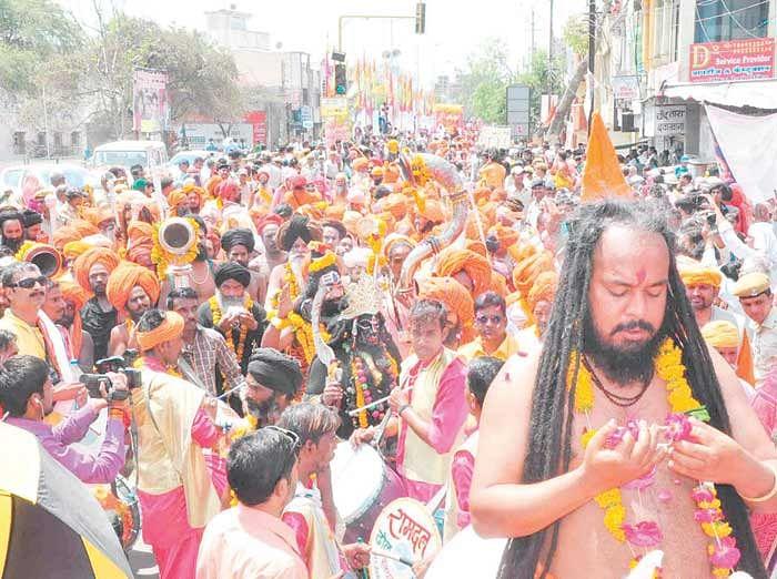 Saints losing in the spiritual glee at Bada Udasin Akhara Peshwai. FP photo