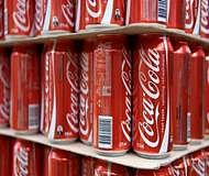 New design for Coke cans to give feel of 'the real thing'