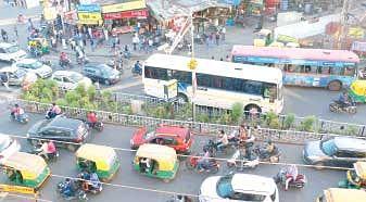Narrow turn, haphazard parking create disorder at Bhawarkuan Square
