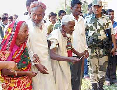 Erstwhile Bangladeshi enclave dweller 103-year-old  Asgar Ali is helped by his family members to cast his vote for the first time at a polling station in Coochbehar district on Thursday.