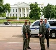 Gun-wielding man outside White House refuses to stop, shot at