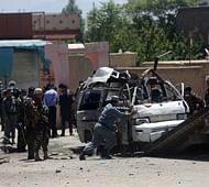 Taliban bomber hits court minibus in Kabul, killing 11