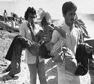In this Decembers 5, 1984, photo, two men carry children blinded by the Union Carbide chemical pesticide leak to a hospital in Bhopal