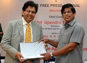 Upendra Tripathy, Secretary, Ministry of New and Renewable Energy, Government of India felicitating Dilip Piramal, President, Indian Merchants' Chamber on behalf of The Free Press Journal