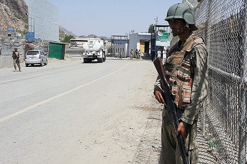 Pakistani soldiers patrol at the Torkham crossing between Pakistan and Afghanistan