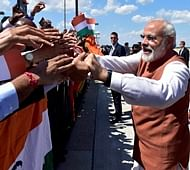 Washington: Prime Minister Narendra Modi meeting Indian community people on his arrival at Joint Base Andrews (JBA), in Washington D.C., USA on Monday. PTI Photo by Kamal Kishore(PTI6_7_2016_000004B)