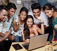 Mumbai: Students celebrate their success as they check their results online after Maharashtra State Board HSC results were declared, in Thane, Mumbai on Wednesday. PTI Photo  (PTI5_25_2016_000072B) *** Local Caption ***