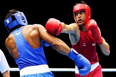 Boxers Satish, Sumit advance at Olympic qualifier