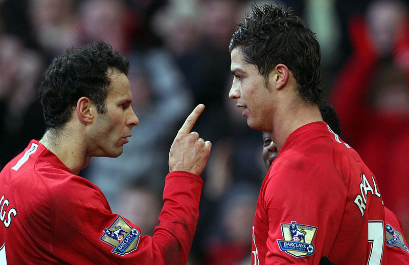 Ryan Giggs (L) of Manchester United celebrates with Cristiano Ronaldo after Ronaldo's penalty winning the match 2-0 during the Premier league football match against Everton at Old Trafford, Manchester, north-west England, 23 December 2007. AFP PHOTO/ANDREW YATES  Mobile and website use of domestic English football pictures are subject to obtaining a Photographic End User Licence from Football DataCo Ltd Tel : +44 (0) 207 864 9121 or e-mail accreditations@football-dataco.com - applies to Premier and Football League matches. (Photo credit should read ANDREW YATES/AFP/Getty Images)