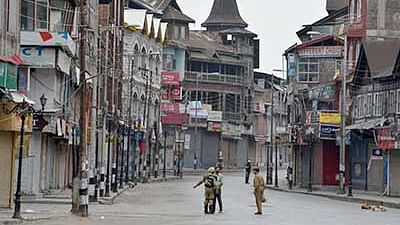 Indian paramilitary troopers stand guard during a curfew in Srinagar