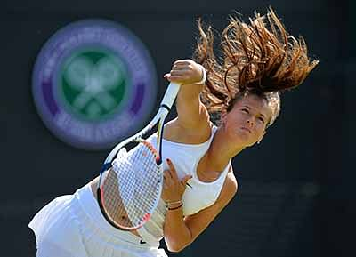 Russia's Daria Kasatkina serves to US player Venus Williams during their women's singles third round match on the fifth day of the 2016 Wimbledon Championships at The All England Lawn Tennis Club in Wimbledon, southwest London, on July 1, 2016. / AFP PHOTO / GLYN KIRK / RESTRICTED TO EDITORIAL USE