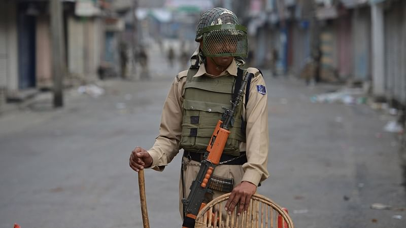 An Indian paramilitary troop stands guard during a curfew in Srinagar on July 10, 2016.   Representational image