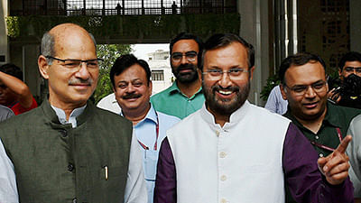 New environment minister Anil Madhav Dave accompies his predecessor Prakash Javadekar as he leaves from Paryavaran Bhawan