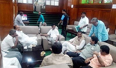 Bengaluru: BJP MLA's sitting on sofa as they relaxing on the sideline of their all night protest to demand the resignation of Minister K J George for his allegedly involvement in the suicide of Dy SP M K Ganapathy, at the state assembly in Bengaluru on Wednesday. PTI Photo(PTI7_13_2016_000252B)