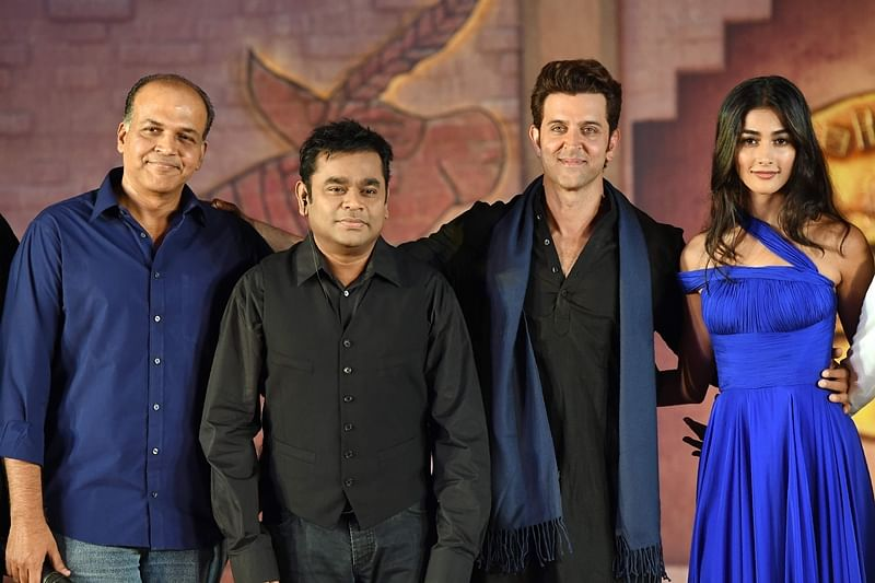 Bollywood actor Hrithik Roshan (2R) poses with actress Pooja Hegde, (R), music director A.R.Rahman (2L) and director Ashutosh Gowariker during the promotion of the new film 'Mohenjo Daro' in Mumbai on July 12, 2016.  Mohenjo Daro is an Indian epic adventure film which is set in the era of the Indus Valley civilisation and is scheduled for release on August 12, 2016. / AFP PHOTO / PUNIT PARANJPE