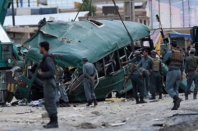 Suicide attack on Afghan police convoy kills 37