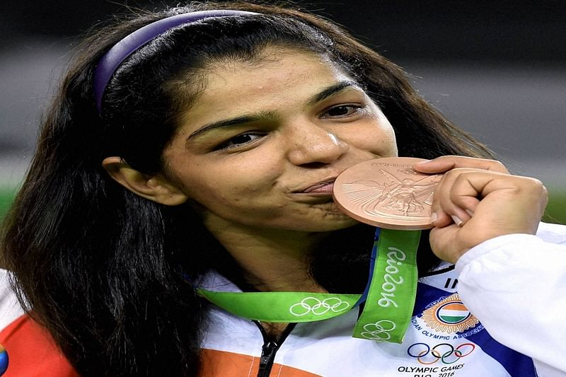 Rio de Janeiro: India's Sakshi Malik poses with her bronze medal for the women's wrestling freestyle 58-kg competition during the medals ceremony at the 2016 Summer Olympics in Rio de Janeiro, Brazil, Wednesday.   PTI Photo by Atul Yadav(PTI8_18_2016_000009B)