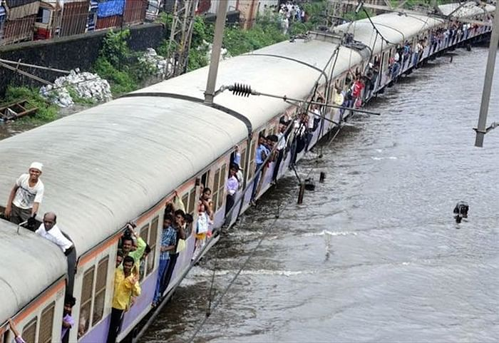 Breaking: Heavy rains lash Mumbai; road, rail, air traffic hit