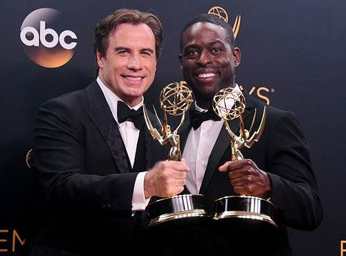 Actor John Travolta (L) and actor Sterling K. Brown