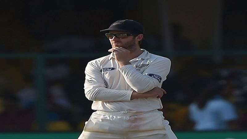 New Zealand's captain Kane Williamson watches a misfield during the third day of the first Test match between India and New Zealand at Green Park Stadium in Kanpur on September 24, 2016. / AFP PHOTO / PRAKASH SINGH / ----IMAGE RESTRICTED TO EDITORIAL USE - STRICTLY NO COMMERCIAL USE----- / GETTYOUT