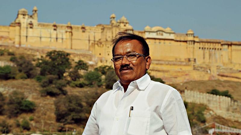 Parsekar defends Parrikar's frequent visits to Goa