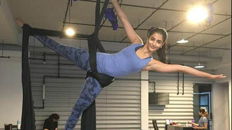 Pooja Hegde learns the art of Aerial silk to keep herself fit