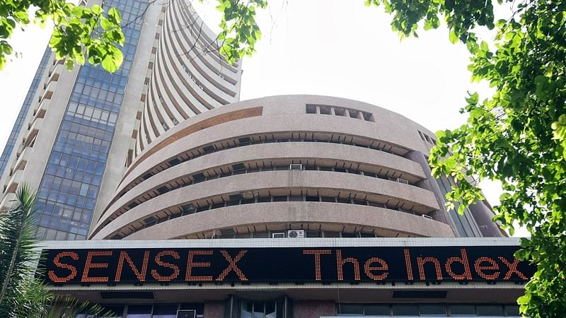 Sensex slips 137 points in volatile trade