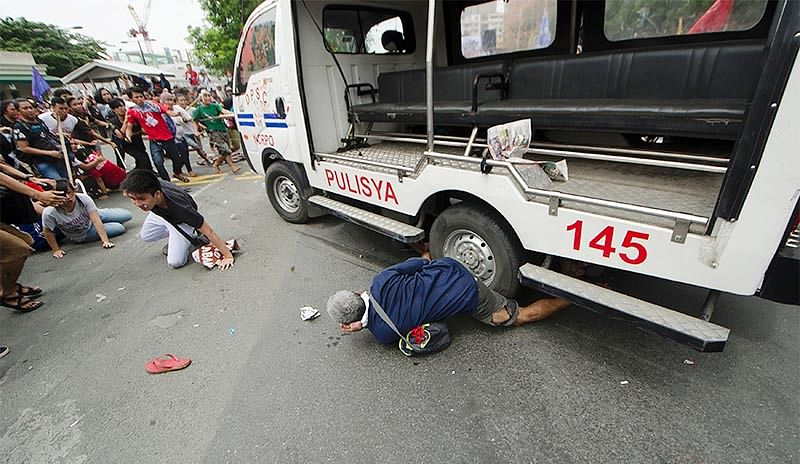 Several injured after police van  rams into protesters in Philippines