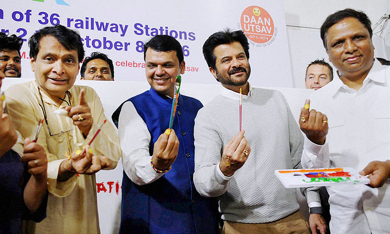 Mumbai: Union Railway Minister Suresh Prabhu (L), Chief Minister of Maharashtra Devendra Fadanvis (2nd L) and Bollywood actor Anil Kapoor during the launch of beautification of 36 Suburban Railway Staitions of Mumbai on the occasion of Gandhi Jayanti, in Mumbai on Sunday. PTI Photo   (PTI10_2_2016_000101B)