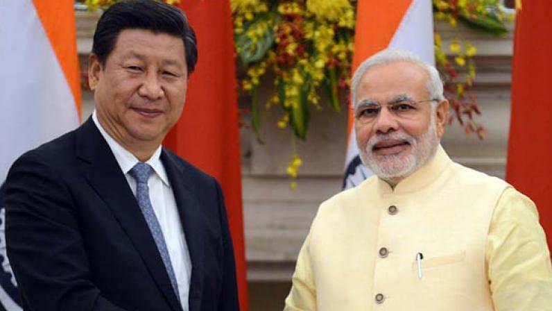 China President Xi Jinping (L) and (R) Prime Minister of India Narendra Modi